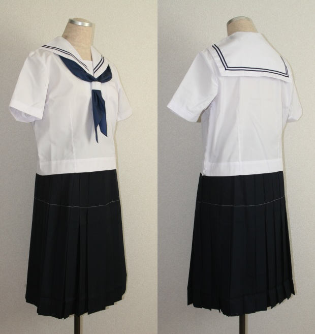 This is very similar to what we wore but we didn't have the navy stripes on the back and although our skirts were supposed to be this length, we all shortened them into mini skirts!