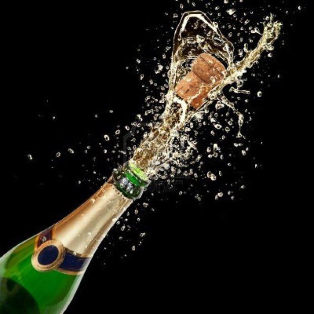 16725449-celebration-theme-with-splashing-champagne-isolated-on-black-background